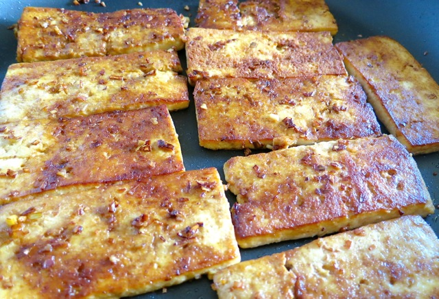 tofu is quickly marinated and pan fried until crispy on